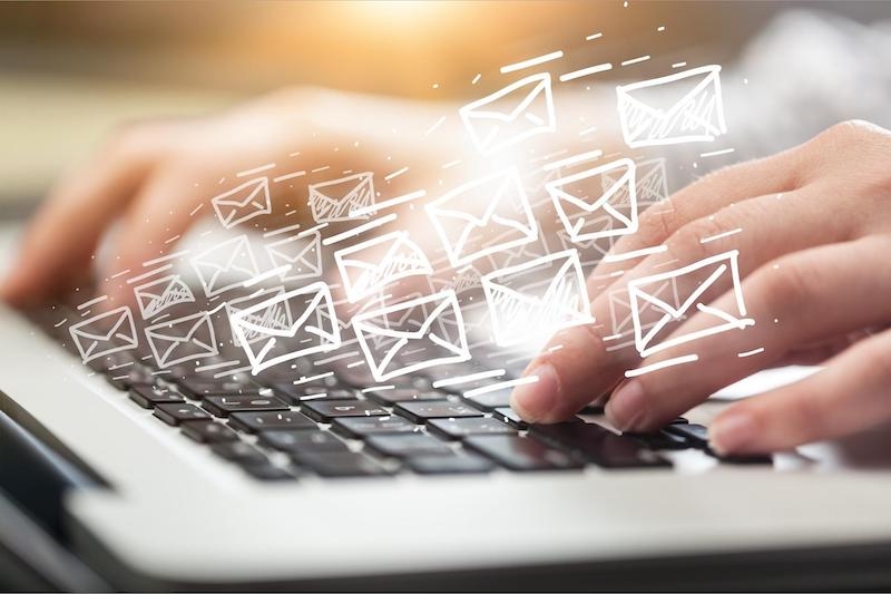 Deliverability: Email icons coming out of a laptop
