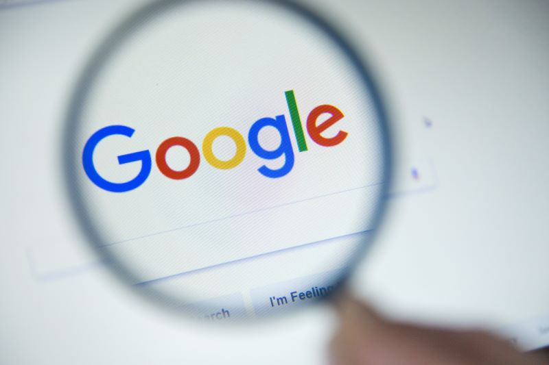 Lead generation strategies: Magnifying glass over Google logo