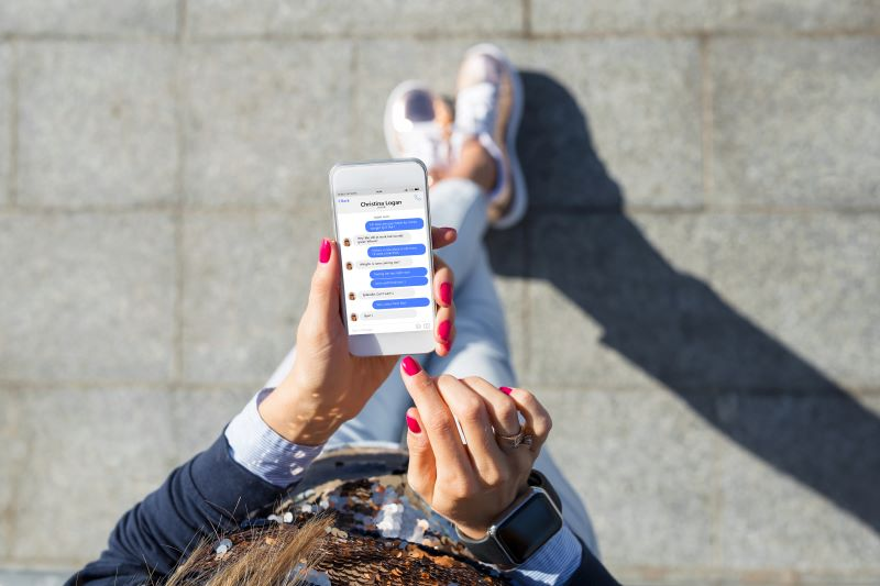 Person using messaging app on their smartphone