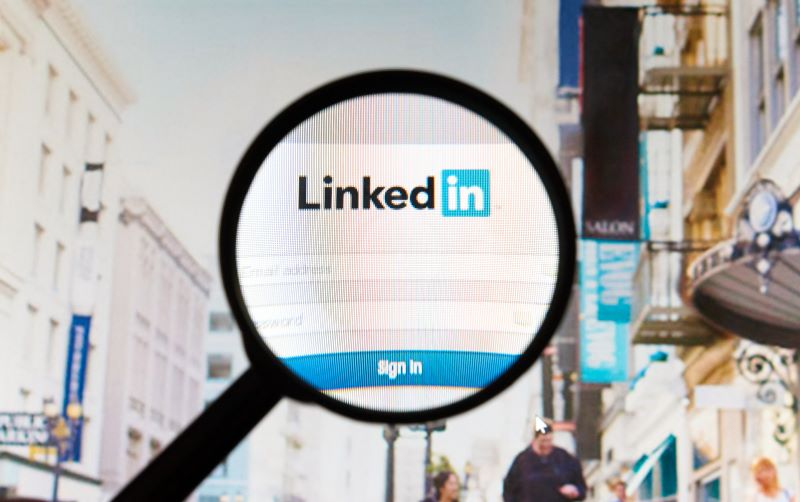 Magnifying glass over LinkedIn login page