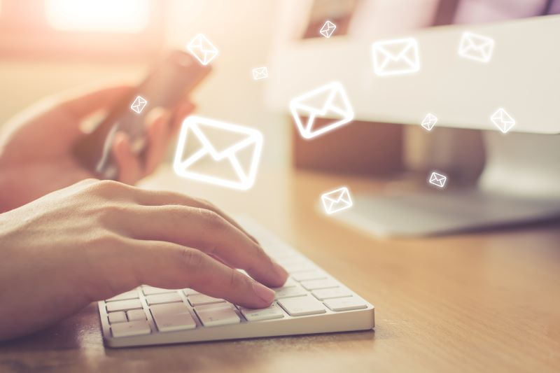 email marketing metrics: hands typing emails
