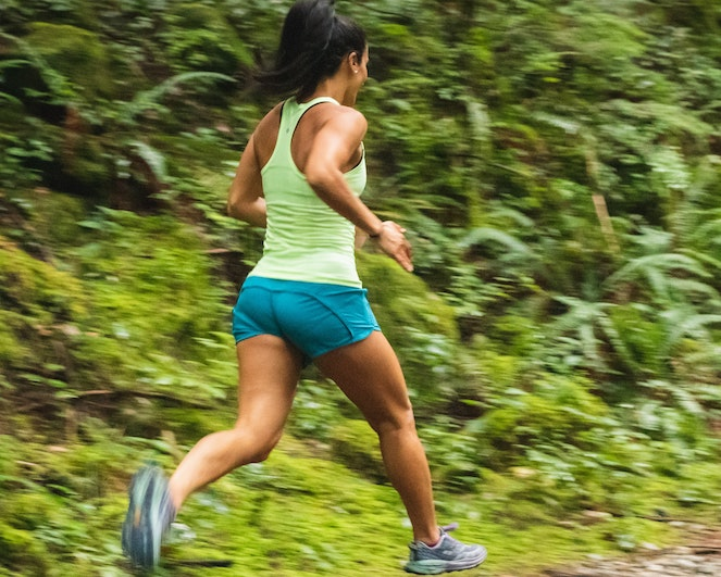 Woman running on an outdoor trail